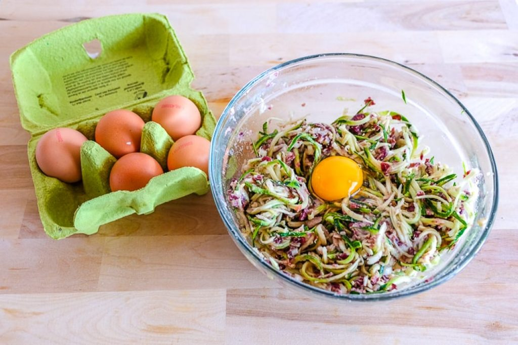 eggs in carton and bowl of ingredients zucchini fritters recipe