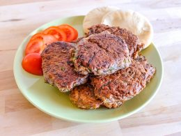 plate of bean zucchini fritters recipe with tomato and pita