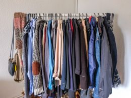 clothing rack with sweaters and jackets how to store your clothes without a closet or dresser