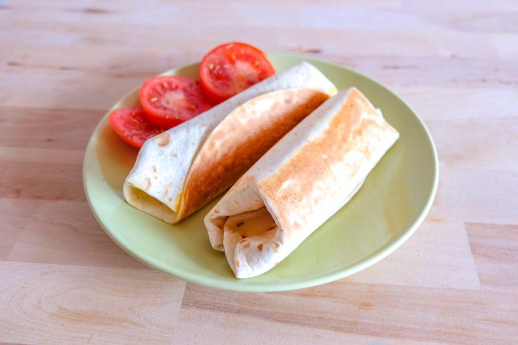 grilled wraps with tomato on green plate grilled tomato mozzarella wraps