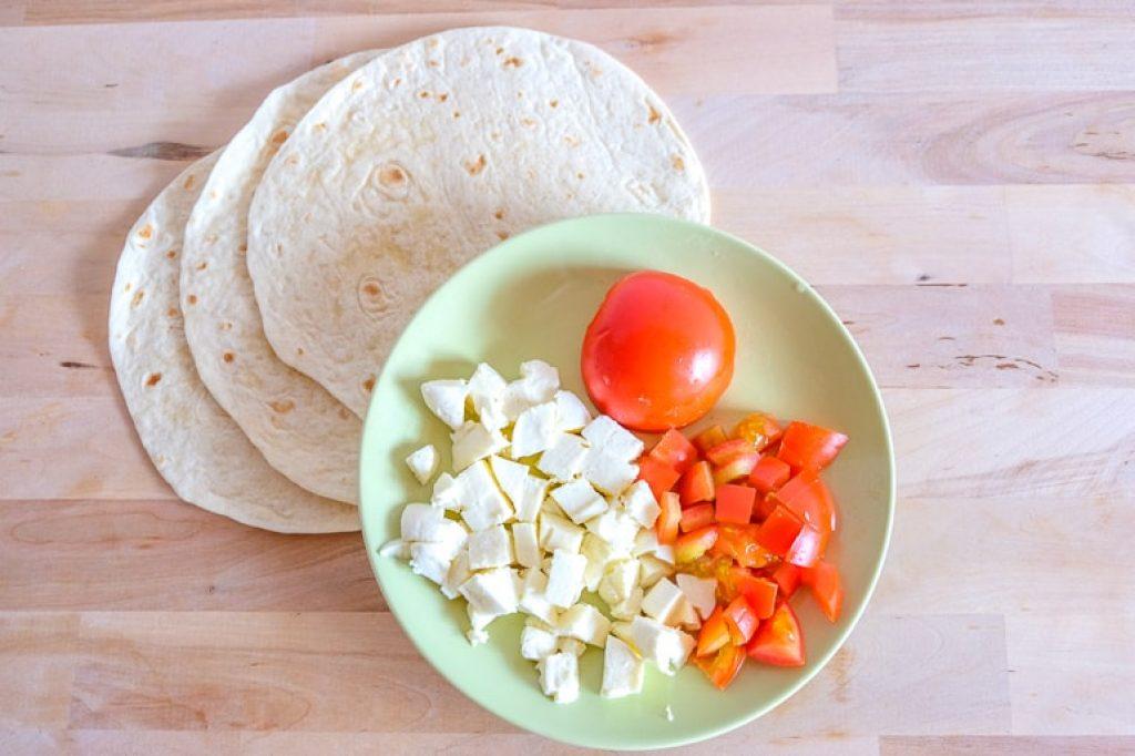 chopped cheese and tomato on plate grilled tomato mozzarella wraps
