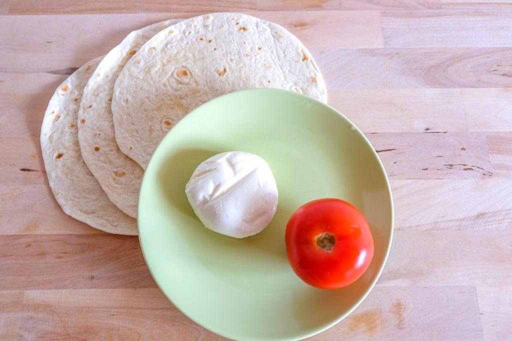 tomato and mozzarella ball on plate with wraps grilled tomato mozzarella wraps