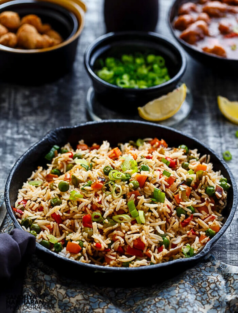 large pan of fried rice on table with other bowls healthy meals