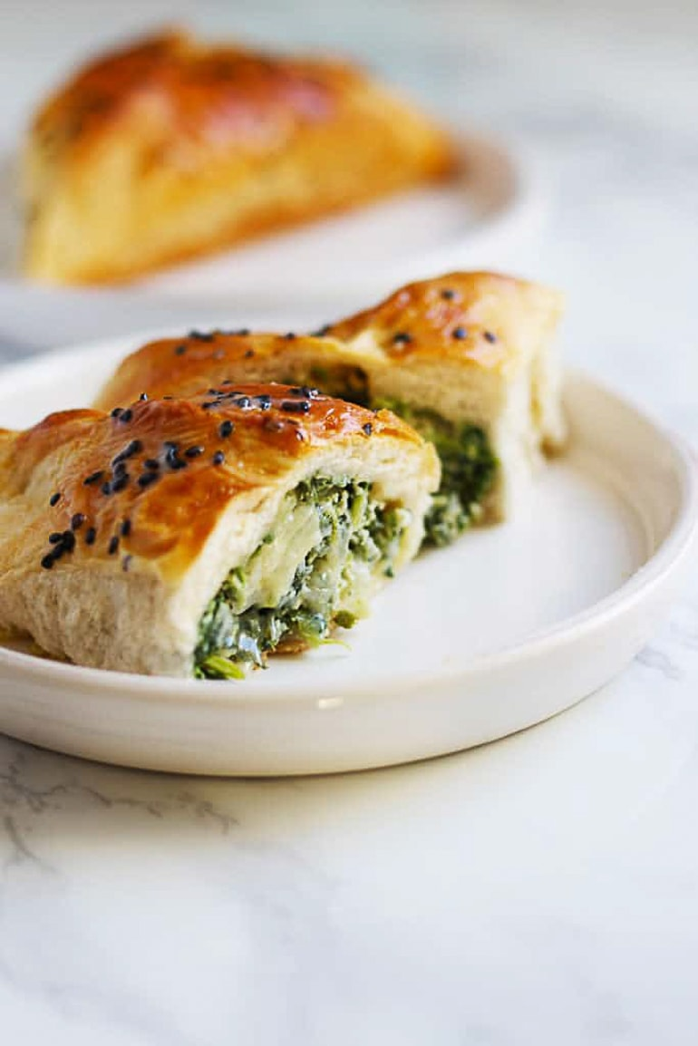 roll filled with spinach on white plate healthy meals