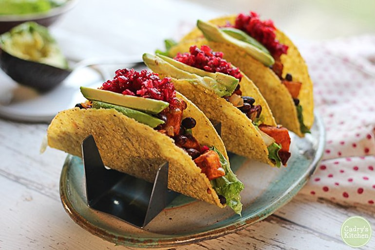 tacos on taco stand on table healthy black bean tacos