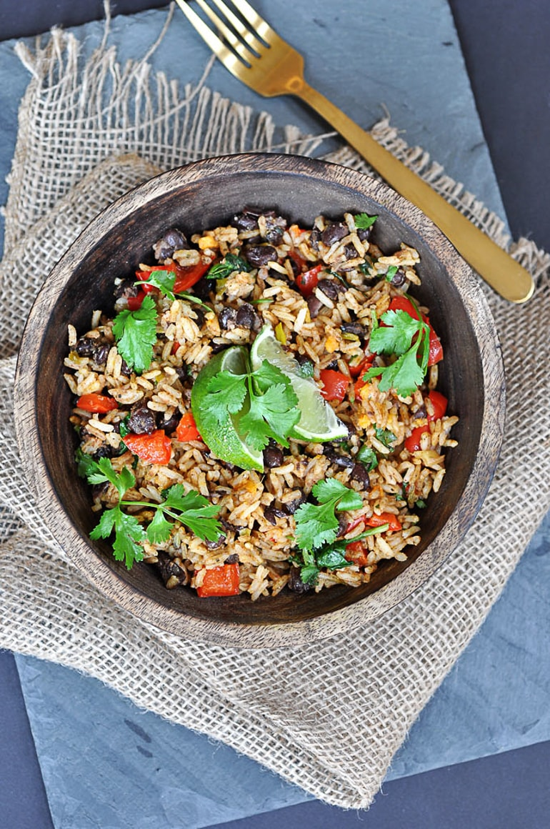 black beans and rice dish on table with fork