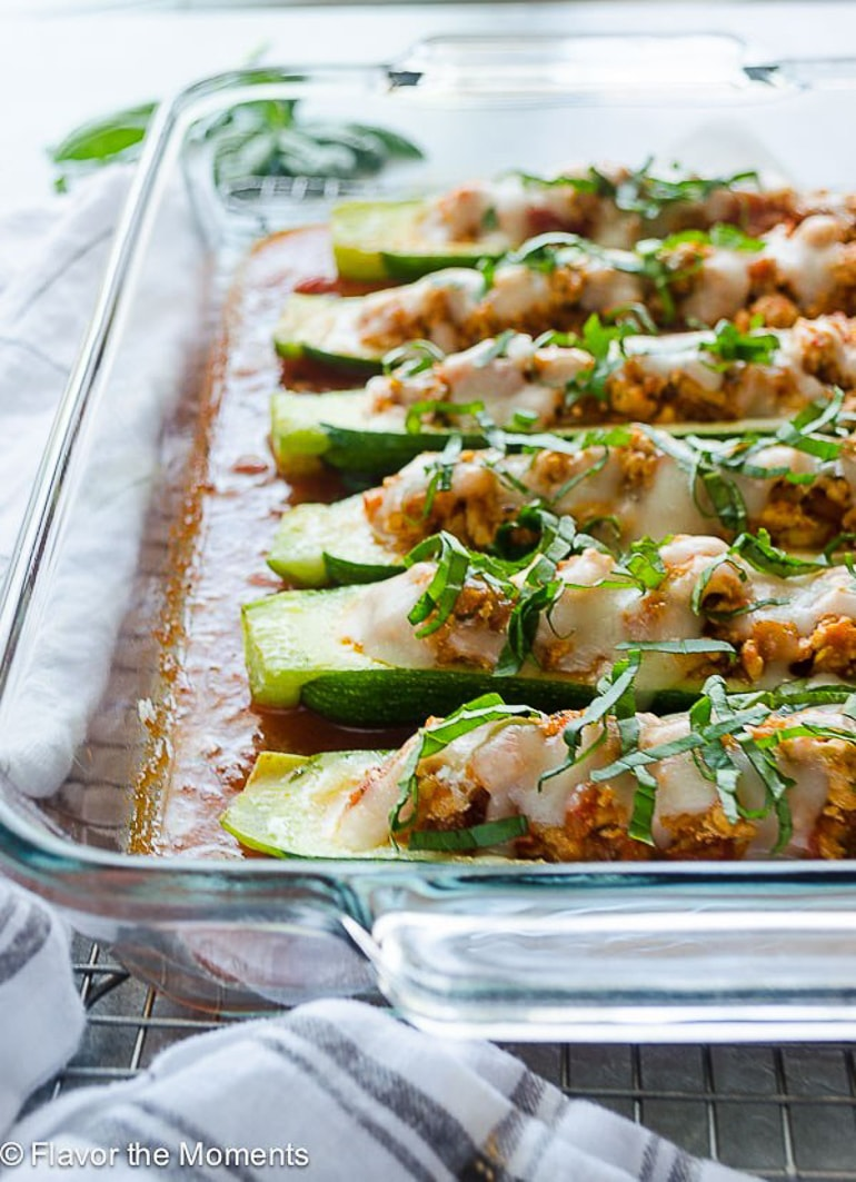 zucchini boats with chicken in pan