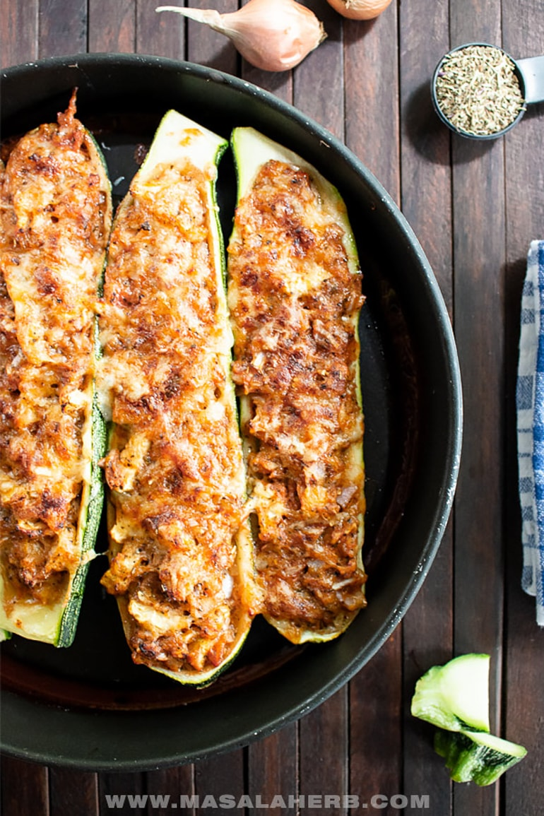 zucchini boats on black plate