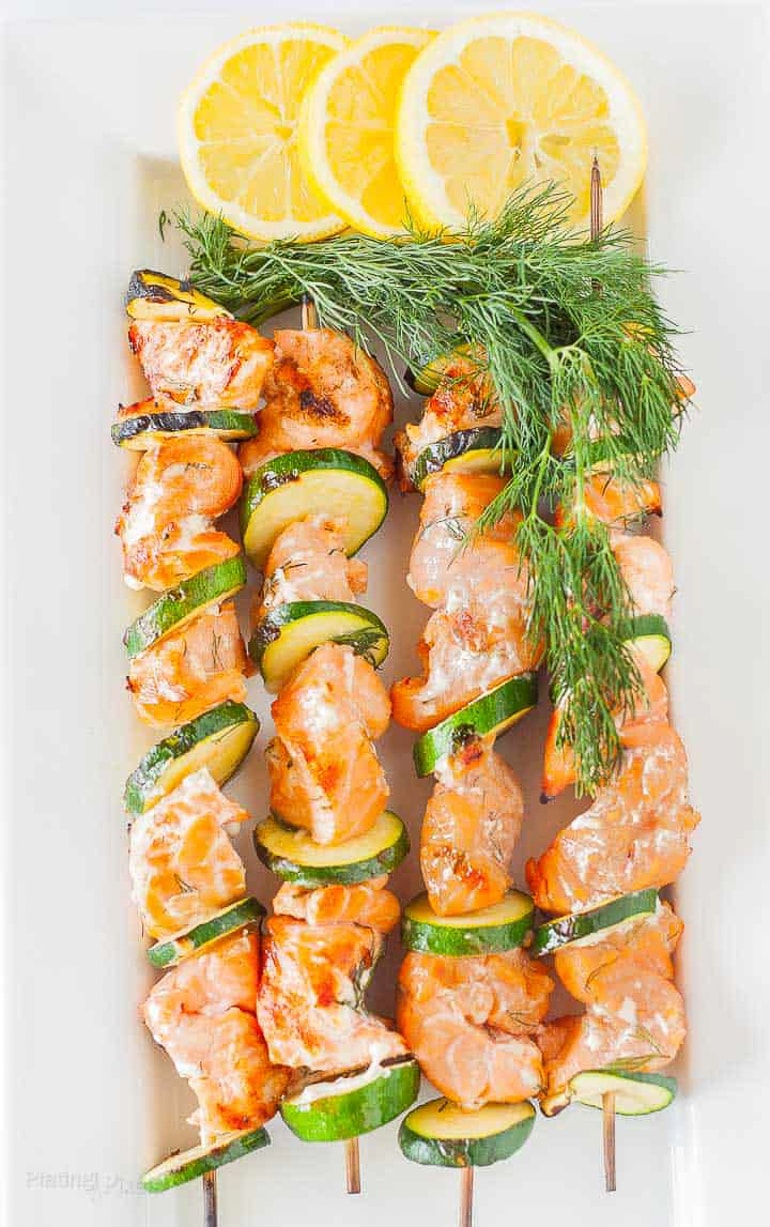 salmon kabobs on skewers with lemon slices