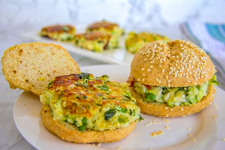 green and yellow halloumi burgers on white plate