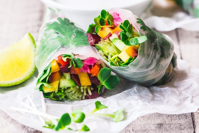 Fresh vegetables rolled in rice paper summer rols with lime