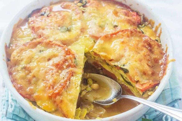 layered casserole with serving spoon sticking out