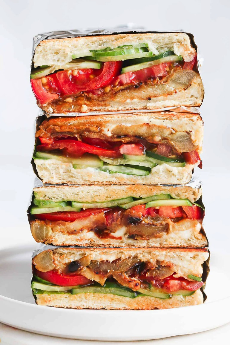 stacked sandwiches with cucumber, tomato and eggplant