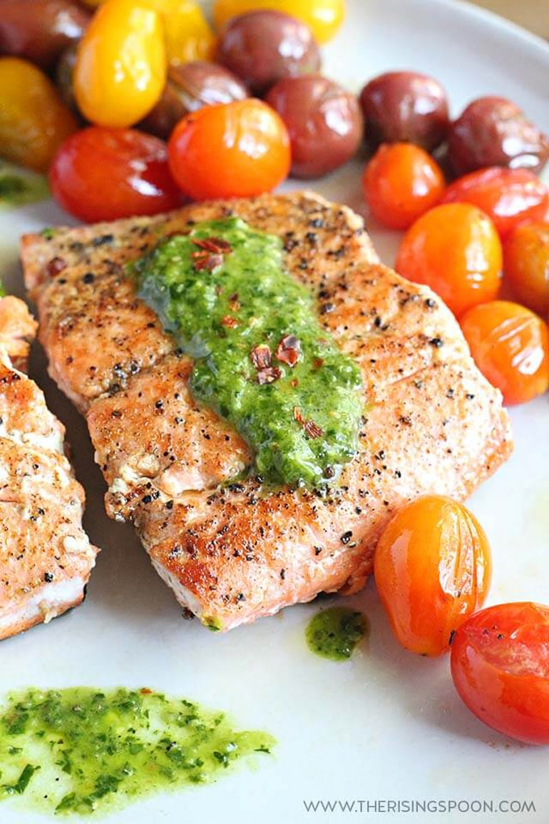 seared salmon steaks on plate with cherry tomatoes