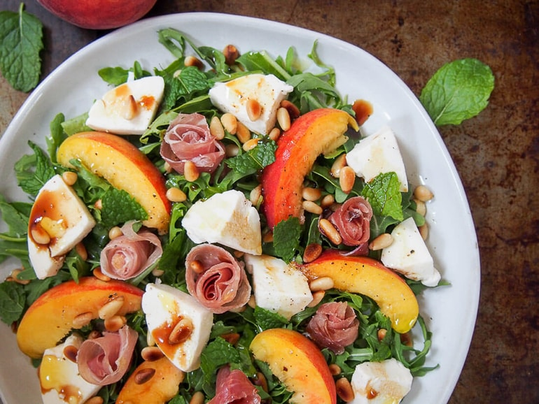 mozzarella chunks with peach slices in salad