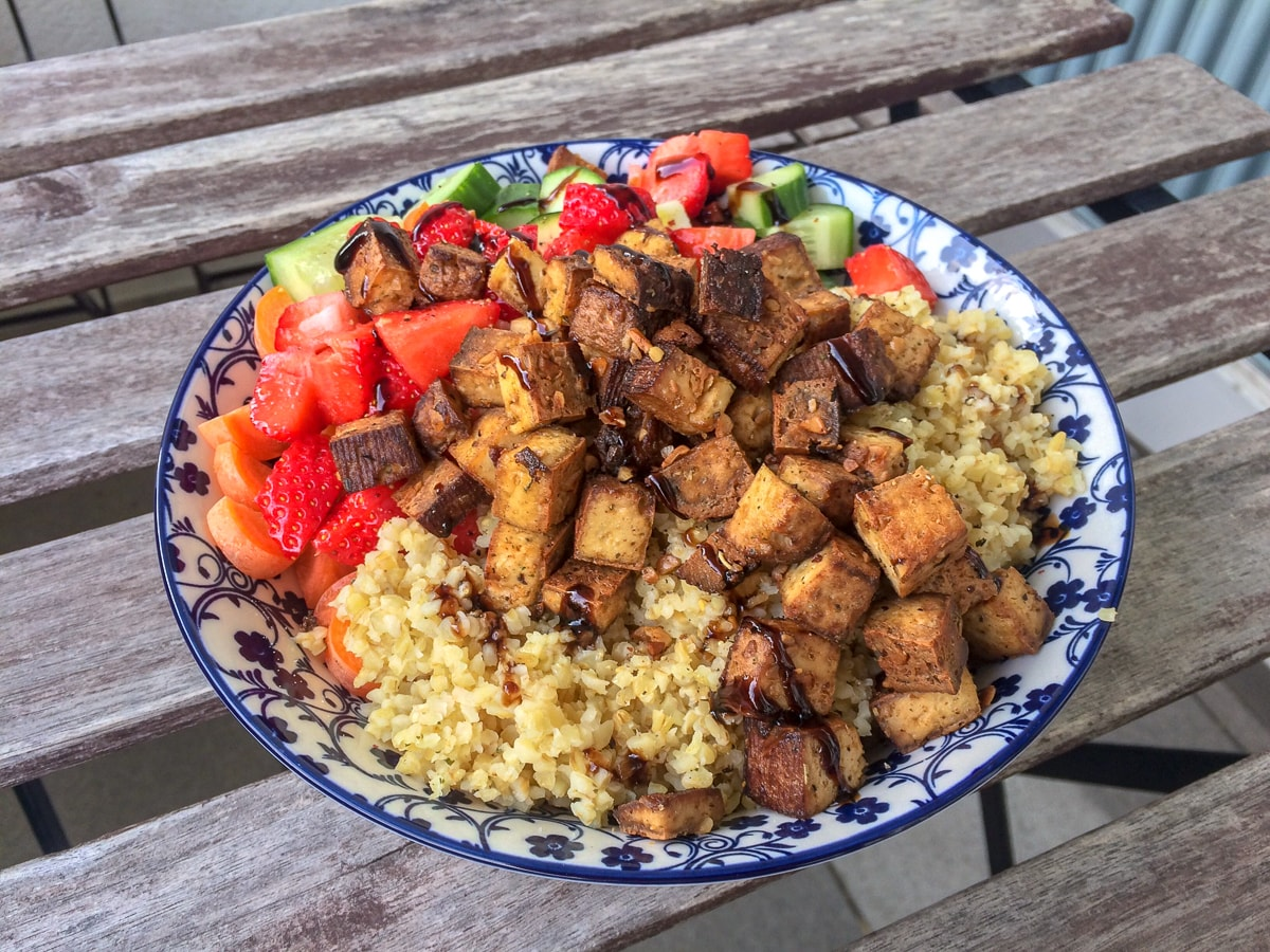bowl of tofu and vegetables on wooden table