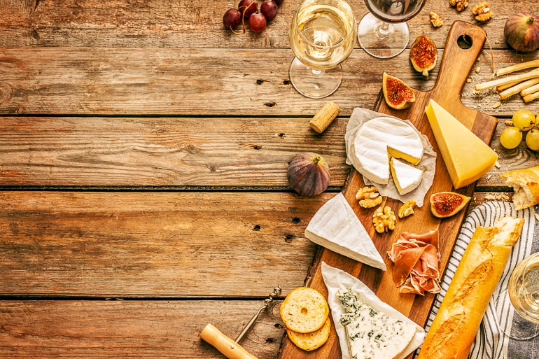 various cheeses on wooden table date night at home ideas