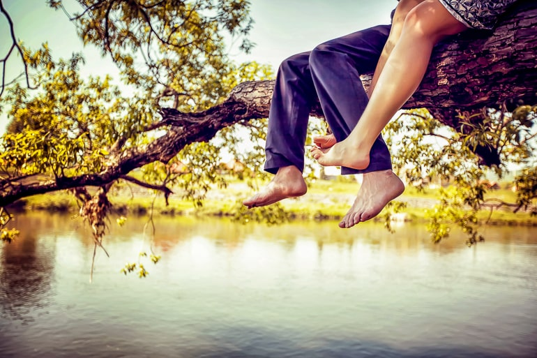 legs dangling off tree branch over water dating an introvert