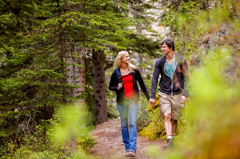 man and woman walking on hike in forest good first date ideas