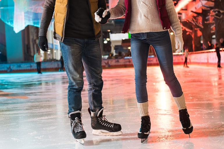 two people ice skating on ice rink