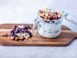 yogurt and berries on wooden board on counter healthy afternoon snacks