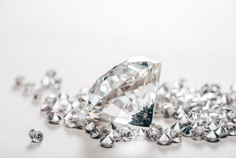 Diamonds reflecting light with white background
