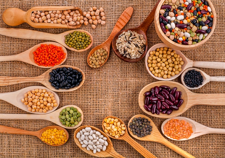 Legumes on wooden spoons healthy eating on a budget