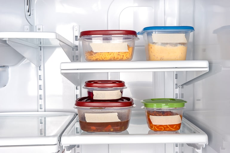 Tupperware containers with labels in fridge