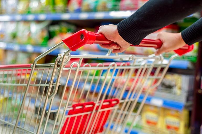 Hands holding shopping cart