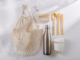 Wooden utensils reusable water bottle coffee mug and grocery bag how to reduce plastic waste at home