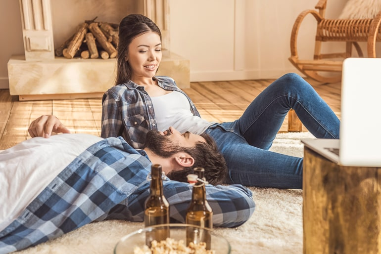 couple sitting in floor together chatting
