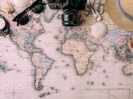 Photo of word map with camera sunglasses hat seashells and more on top long distance date ideas