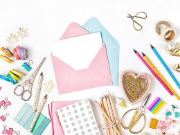 Envelopes and craft suppplies on white table long distance relationship gifts