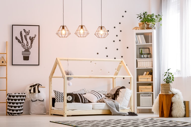 Kids bedroom with wood tones plants and simple decor items