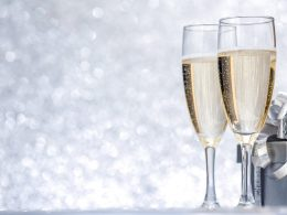 two champagne glasses with silver background new years eve party supplies