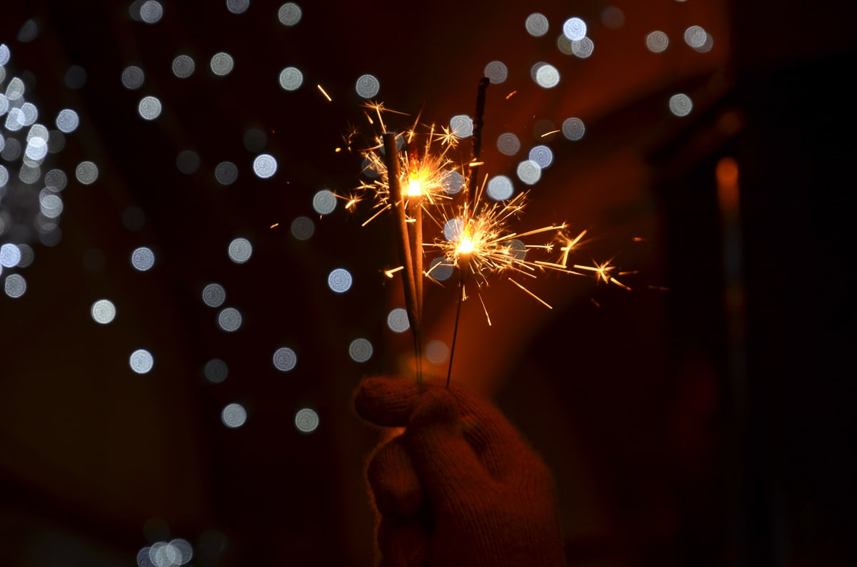 sparklers glowing with dark background new years resolution ideas