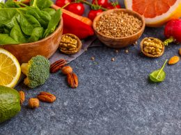 vegetables and nuts on dark counter top alkaline foods