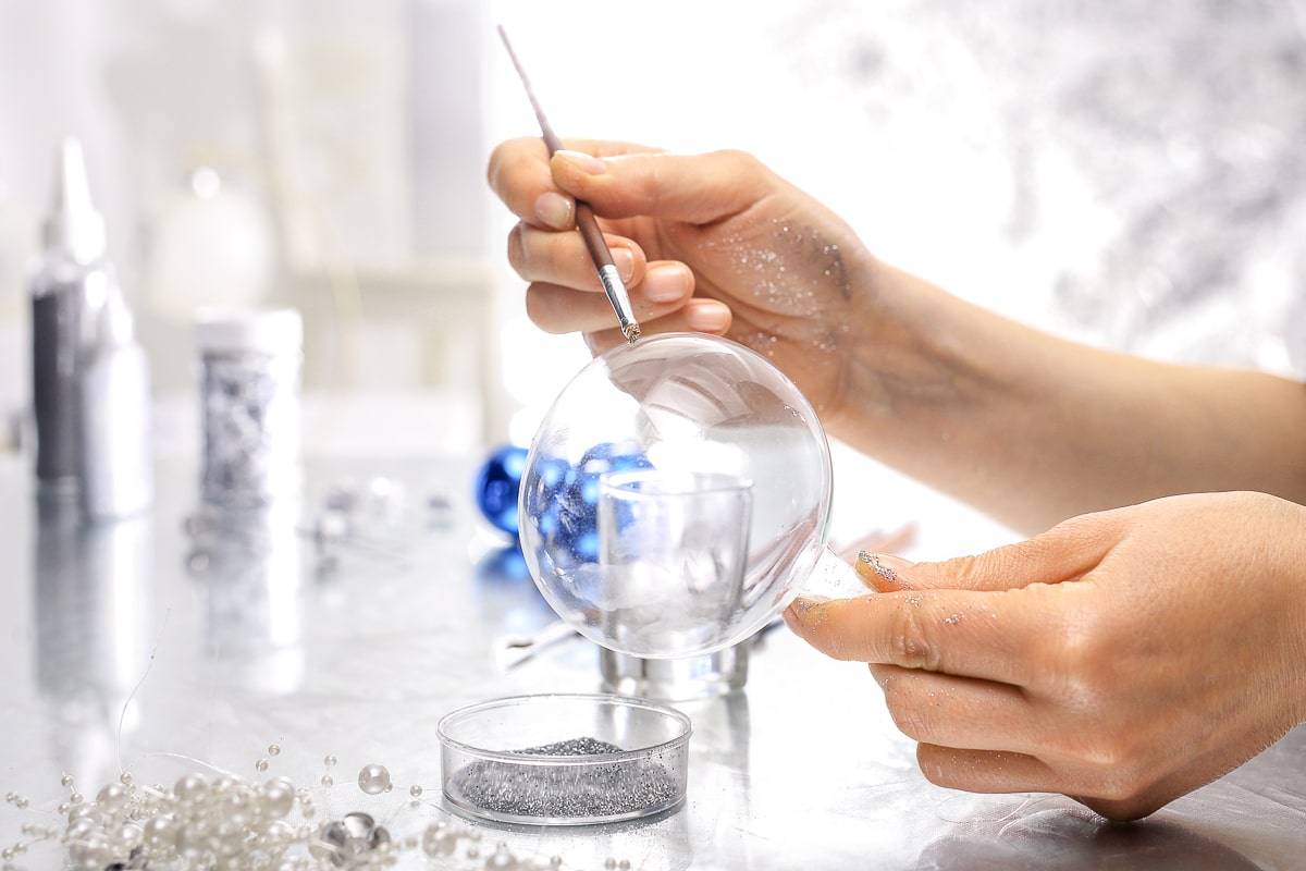 clear glass christmas bulb being painted unique glass christmas ornament
