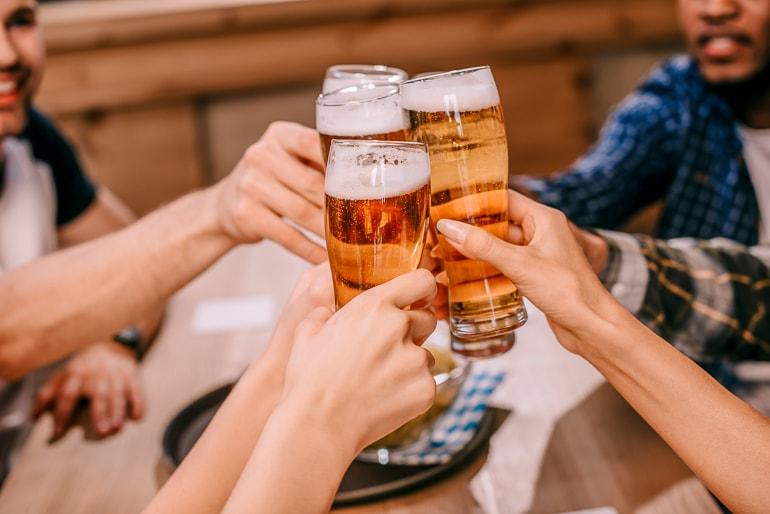 beer glasses held in hands cheering best alcoholic drinks