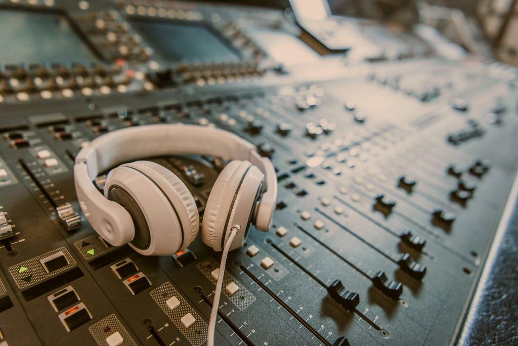 white headphones on mixing table