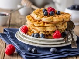 stack of waffles on plate with berries on table waffle recipes