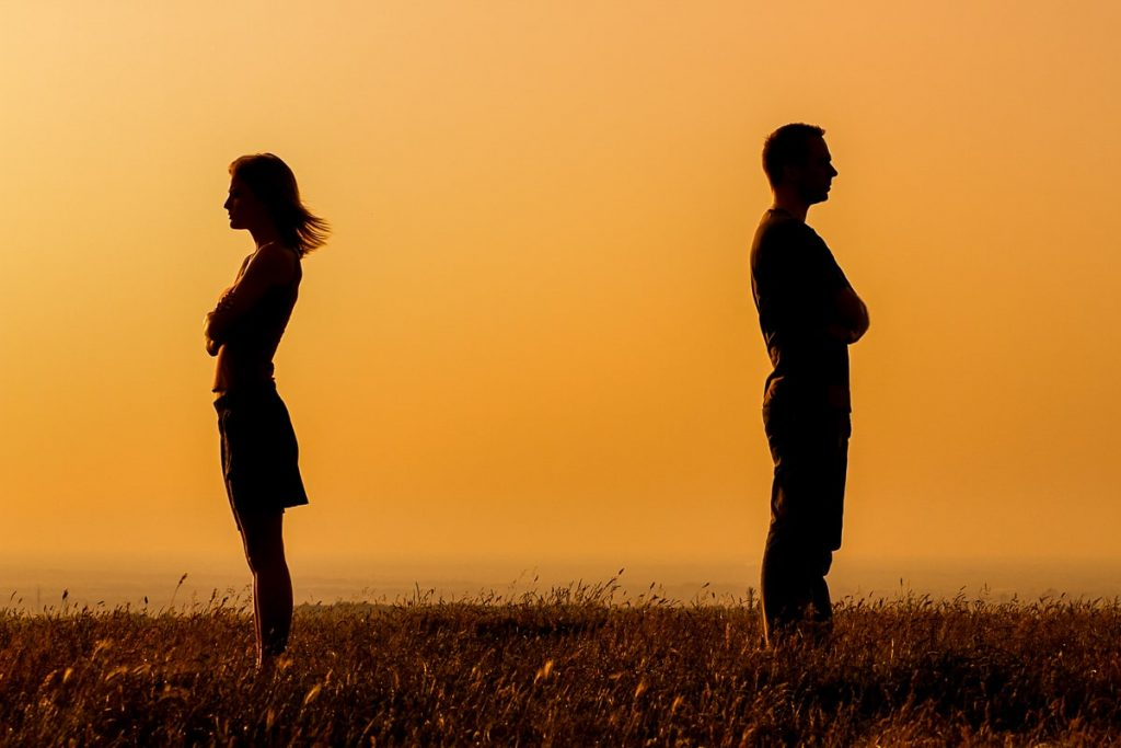 man and woman standing with orange sunset behind how to stop fighting in a relationship
