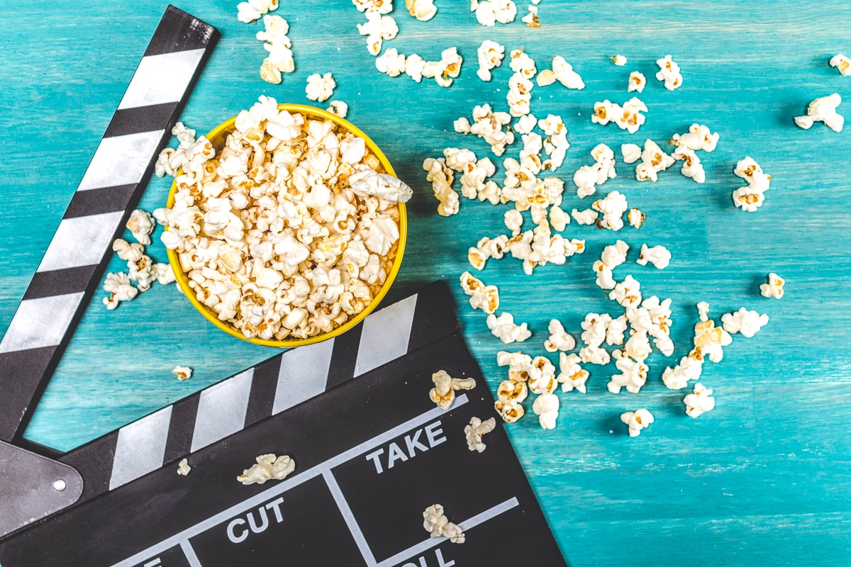 bowl of popcorn on blue table with movie directors tool